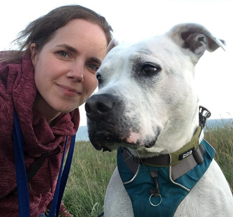 Claire Stallard - Behaviour and Training Development Manager at Blue Cross with white Staffordshire bull terrier