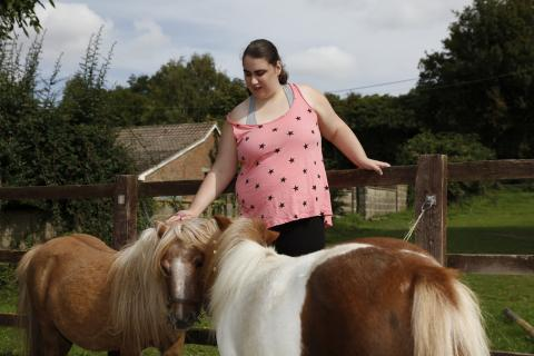 Katy grooming the horses